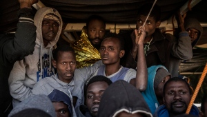 In this Saturday Jan. 14, 2017 photo, migrants from Mali crowd the deck of the Golfo Azzurro vessel after being rescued from the Mediterranean sea, about 20 miles north of Ra's Tajura, Libya.(AP Photo/Olmo Calvo)