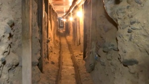 FILE - This Dec. 12, 2016 file image from a video provided by the Mexican Attorney General's Office, or PGR, shows one of two tunnels found in an area of warehouses in the border city of Tijuana that lead into California. (Mexico's Attorney General's Office via AP, File)