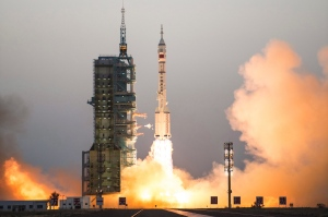 China's Shenzhou 11 spaceship onboard a Long March-2F carrier rocket takes off from the Jiuquan Satellite Launch Center in northwest China's Gansu province on Monday, Oct. 17, 2016. (Chinatopix)