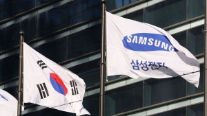 The company flag of Samsung Electronics flutters next to the South Korean national flag in Seoul, South Korea, Monday, Jan. 16, 2017. (AP Photo/Lee Jin-man)