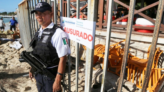 Police guard the exit of the Blue Parrot nightclub in Playa del Carmen, Mexico, Monday, Jan. 16, 2017.  (AP Photo)