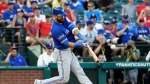 "A person with knowledge of the negotiations tells The Associated Press that outfielder Jose Bautista and the Toronto Blue Jays are ""working really hard"" to bring him back to the club. (AP Photo/David J. Phillip, File)"