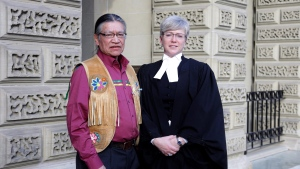 Edmund Metatawabin and lawyer Fay Brunning are seen outside court in Toronto on Wednesday, Dec. 14, 2016. (The CANADIAN PRESS/Colin Perke)