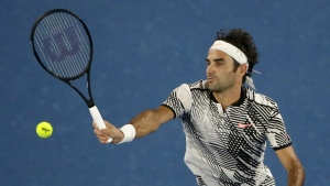 Switzerland's Roger Federer makes a forehand return to Austria's Jurgen Melzer during their first round match at the Australian Open tennis championships in Melbourne, Australia, Monday, Jan. 16, 2017. (AP / Dita Alangkara)