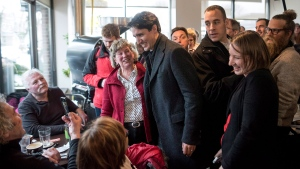 Prime Minister Justin Trudeau greets people at Java Blend Coffee Roasters in Halifax on Monday, January 16, 2017. (THE CANADIAN PRESS/Darren Calabrese)