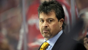 FILE - In this April 5, 2016, file photo, New York Islanders head coach Jack Capuano stands in the bench during the second period of an NHL hockey game against the Washington Capitals in Washington. The struggling islanders fired Capuano on Tuesday, Jan. 17, 2017. (AP Photo/Alex Brandon)