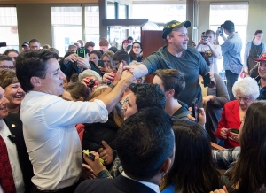 Prime Minister Justin Trudeau is greeted by supporters during a visit to a Tim Hortons in Hampton, N.B. on Tuesday, Jan. 17, 2017. (THE CANADIAN PRESS/Andrew Vaughan)