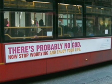An ad on the side of the bus questions the existence of God.