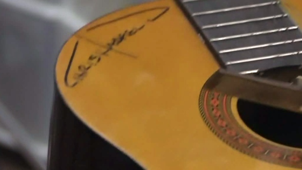 Hadfield's guitar is seen here.