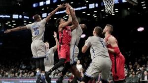 Toronto Raptors guard DeMar DeRozan shoots against Brooklyn Nets guard Caris LeVert during the second quarter of an NBA basketball game in New York on Tuesday, Jan. 17, 2017. (AP / Julie Jacobson)