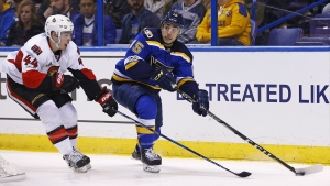 St. Louis Blues' Robby Fabbri, right, looks to pass the puck as he is pressured by Ottawa Senators' Jean-Gabriel Pageau during the second period of an NHL hockey game, Tuesday, Jan. 17, 2017, in St. Louis. (AP / Billy Hurst)