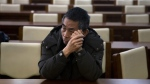 A relative of passengers onboard the missing Malaysian Airlines MH370 waits for a meeting with Malaysia Airlines officials in Beijing on Wednesday, Jan. 18, 2017. (AP / Ng Han Guan)