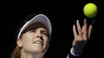 Canada's Eugenie Bouchard serves to China's Peng Shuai during their second round match at the Australian Open tennis championships in Melbourne, Australia on Wednesday, Jan. 18, 2017. (AP / Aaron Favila)