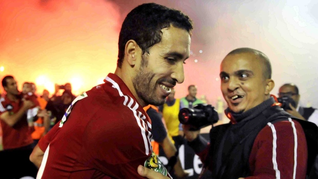 Egyptian Al Ahly club player Mohamed Aboutrika is embraced by a fan, on Nov. 10, 2013. (Osama Abdel Naby / AP)