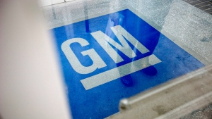 The logo for General Motors decorates the entrance at the site of a GM information technology center in Roswell, Ga. (AP Photo/David Goldman, File)