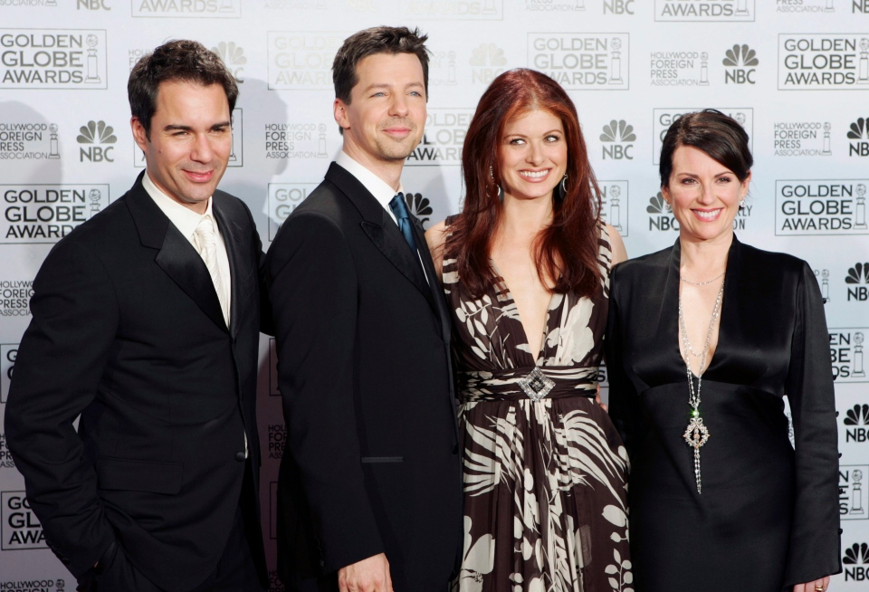 In this Jan. 16, 2006 file photo, cast members from the comedy series 'Will and Grace,' from left, Eric McCormack, Sean Hayes, Debra Messing and Megan Mullally, pose backstage after making an award presentation at the 63rd Annual Golden Globe Awards in Beverly Hills, Calif. (AP / Reed Saxon)