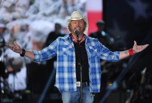 In this April 7, 2014, file photo shows Toby Keith performs at ACM Presents an All-Star Salute to the Troops in Las Vegas. (Photo by Chris Pizzello/Invision/AP)