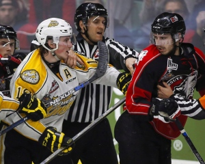 Brandon Wheat Kings' Nolan Patrick, left, and Rouyn-Noranda Huskies' Anthony-John Greer are separated as they scuffle during third period CHL Memorial Cup hockey action in Red Deer, Saturday, May 21, 2016. (Jeff McIntosh / THE CANADIAN PRESS)