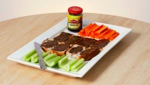 In this undated photo provided by Kraft Foods Australia shows the yet to be named new version of the iconic Down Under vegetable spread Vegemite - a salty, slightly bitter spread made from brewer's yeast. (AP Photo/Kraft Foods, HO)