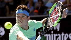Canada's Milos Raonic makes a backhand return to Luxembourg's Gilles Muller during their second round match at the Australian Open tennis championships in Melbourne, Australia on Thursday, Jan. 19, 2017. (AP / Aaron Favila)