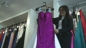 Brittany Woodworth holds up a dress in her store Timeless Moments on Wed., Jan. 18, 2017. (CTV News)