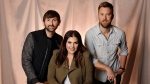 In this Jan. 9, 2017, photo, the members of Lady Antebellum, from left, Dave Haywood, Hillary Scott, and Charles Kelley pose in Nashville, Tenn. (AP Photo/Mark Humphrey)