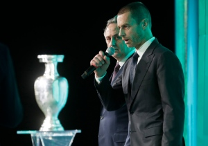 UEFA President Aleksander Ceferin, foreground, speaks, and Vitaly Mutko, Russia's deputy prime minister in charge of sport, tourism and youth policies listens during the launch ceremony of a logo for the Euro 2020 soccer championship in St.Petersburg, Russia, Thursday, Jan. 19, 2016. (AP Photo/Dmitri Lovetsky)