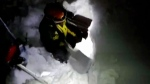 This photo taken from a video shows rescuers shovel snow in the avalanche area following the avalanche in Farindola, Italy, early Thursday, Jan. 19, 2017. A hotel in the mountainous region hit again by quakes has been covered by an avalanche, with reports of dead. Italian media say the avalanche covered the three-story hotel in the central region of Abruzzo, on Wednesday evening. (Italian Finance Police via AP)