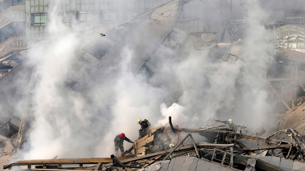 Firefighters work at the scene of the collapsed Plasco building after being engulfed by a fire, in central Tehran, Iran, Thursday, Jan. 19, 2017. (AP Photo/Ebrahim Noroozi)