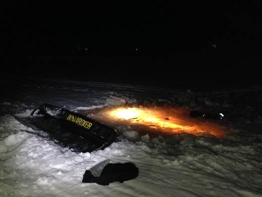 A trail grooming machine is seen partially submerged through the ice on Lake McMullin near Val-des-Monts on Jan 18, 2017. (MRC des Collines photo)