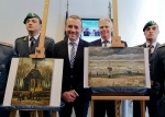 In this Friday, Sept. 30, 2016 file photo, Director of Amsterdam's Van Gogh Museum Axel Rueger, centre, stands next to the paintings 'Congregation Leaving The Reformed Church of Nuenen', left, and 1882 'Seascape at Scheveningen' by Vincent Van Gogh, during a press conference in Naples, Italy. (Ciro Fusco / ANSA via AP)