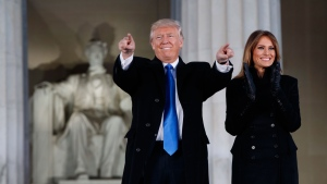 "President-elect Donald Trump, left, and his wife Melania Trump arrive to the ""Make America Great Again Welcome Concert"" at the Lincoln Memorial, in Washington, Thursday, Jan. 19, 2017, (AP Photo/Evan Vucci)"