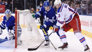 New York Rangers centre Kevin Hayes (13) battles with Toronto Maple Leafs defenceman Jake Gardiner (51) as Maple Leafs goalie Frederik Andersen (31) looks on during first period NHL action in Toronto, Thursday, January 19, 2017. (Frank Gunn/The Canadian Press)