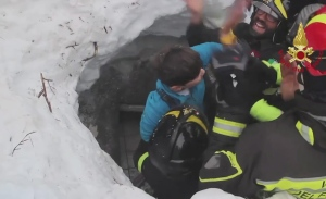 This frame from video shows Italian firefighters extracting a child alive from under snow and debris of an hotel that was hit by an avalanche on Wednesday, in Rigopiano, central Italy, Friday, Jan. 20, 2017. (Italian Firefighters / ANSA via AP)