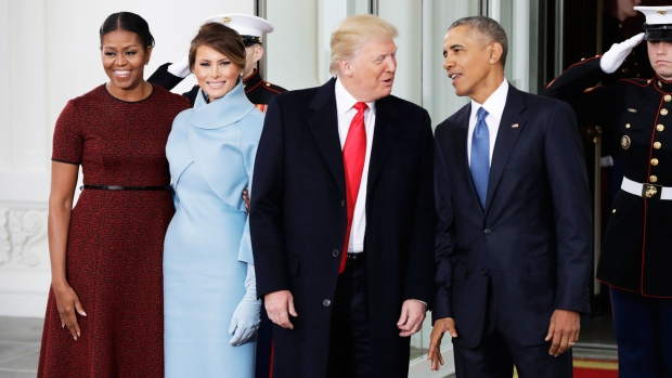 U.S. President Barack Obama and first lady Michelle Obama pose with U.S. President-elect Donald Trump and his wife Melania at the White House in Washington, Friday, Jan. 20, 2017. (AP Photo/Evan Vucci)