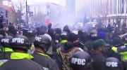 Protesters and police clash on the streets of Washington on Friday, Dec. 20, 2017.