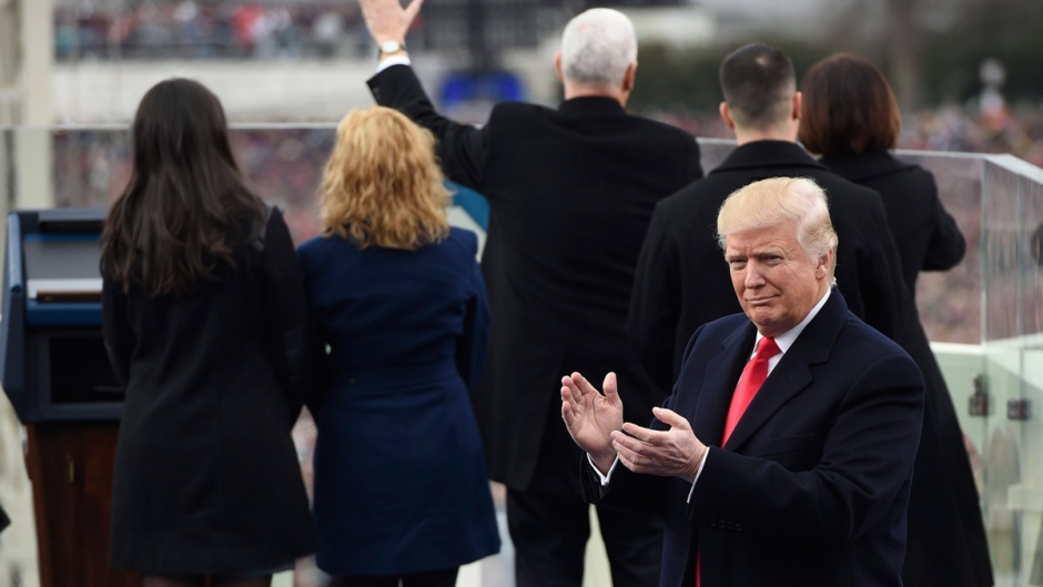 Donald Trump applauds after Vice President Mike Pence was sworn-in on Capitol Hill in Washington, on Jan. 20, 2017. (Saul Loeb / Pool Photo via AP)
