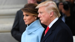 President Donald Trump and first lady Melania Trump depart the 2017 Presidential Inauguration on Capitol Hill in Washington, Friday, Jan. 20, 2017. (Jack Gruber / Pool Photo via AP)