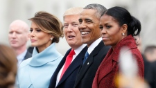 First lady Melania Trump stands with President Donald Trump, President Barack Obama, and former first lady Michelle Obama, as they pause on the steps of the East Front of the U.S. Capitol during a departure ceremony for Obama Friday, Jan. 20, 2017 in Washington. (AP Photo/Alex Brandon)