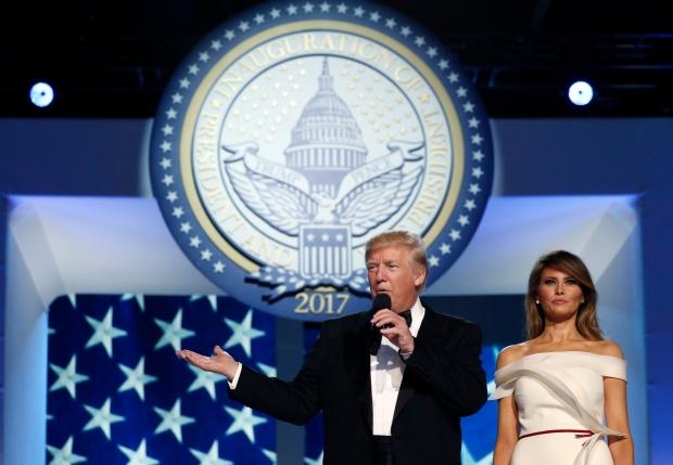 President Donald Trump talks as first lady Melania Trump listens at the Freedom Ball, Friday, Jan. 20, 2017, in Washington. (AP / Alex Brandon)