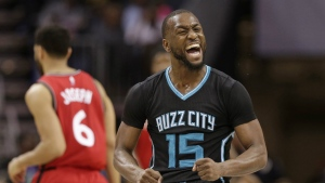 Charlotte Hornets' Kemba Walker (15) reacts to making a basket against the Toronto Raptors during the second half of an NBA basketball game in Charlotte, N.C., Friday, Jan. 20, 2017. (AP / Chuck Burton)