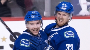 Vancouver Canucks' Sven Baertschi, left, and Henrik Sedin, of Sweden, celebrate Baertschi's second goal against the Colorado Avalanche during the third period of an NHL hockey game in Vancouver, B.C., on Monday January 2, 2017. THE CANADIAN PRESS/Darryl Dyck
