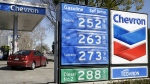 In this Monday, Feb. 8, 2016, file photo, gas prices are displayed at a Chevron gas station in Sacramento, Calif. Chevron reports financial results Friday, July 29, 2016. (AP / Rich Pedroncelli, File)
