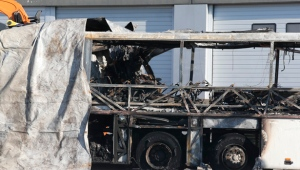 The gutted remains of the bus that crashed along the A4 highway in Verona, Italy, Saturday, Jan. 21, 2017. (AP Photo/Antonio Calanni)