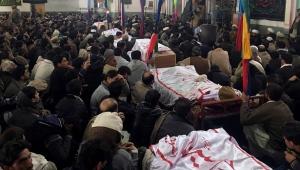 Pakistani Shiite Muslims attend the funeral prayer of the victims of bomb blast at a mosque in Parachinar, the capital of Pakistan's Kurram tribal region, Saturday, Jan. 21, 2017. (AP Photo/Ali Murtaza)