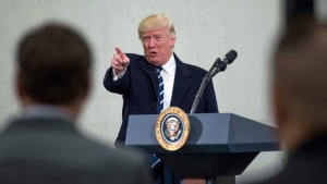 President Donald Trump points to a member of the audience after speaking at the Central Intelligence Agency in Langley, Va., Saturday, Jan. 21, 2017. (AP Photo / Andrew Harnik)