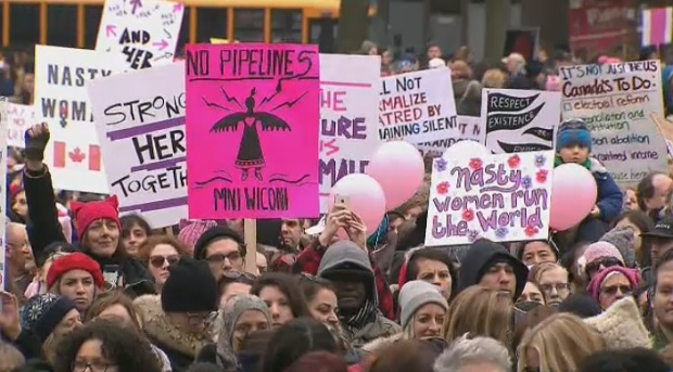 Thousands fill Queen's Park for Toronto's Women's March on Saturday.