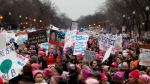 Protesters move along Constitution Avenue at the Women's March on Washington toward the end of the first full day of Donald Trump's presidency, Saturday, Jan. 21, 2017 in Washington. (AP/John Minchillo)