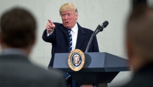 President Donald Trump points to a member of the audience after speaking at the Central Intelligence Agency in Langley, Va., Saturday, Jan. 21, 2017. (AP Photo/Andrew Harnik)