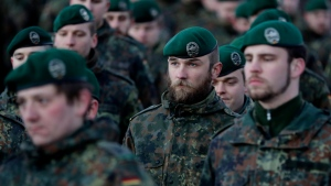 Bundeswehr soldiers headed to Lithuania for NATO take part in a farewell ceremony in Oberviechtach, Germany, Thursday, Jan. 19, 2017. (AP Photo/Matthias Schrader)